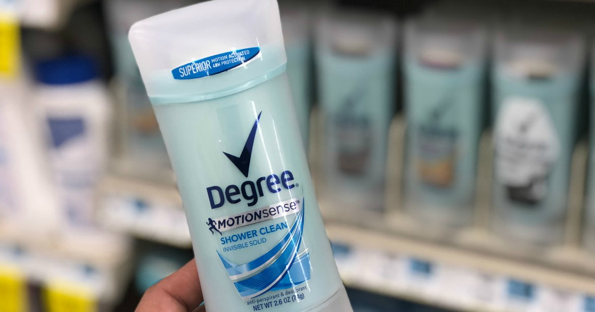 hand holding deodorant in store