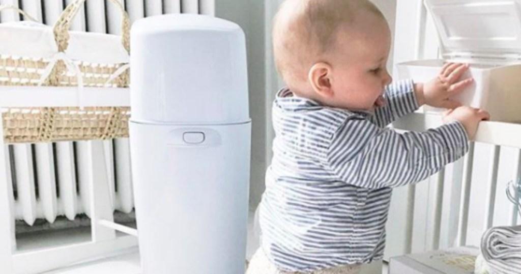 diaper genie in nursery with baby