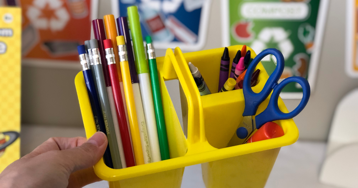 Yellow school supply caddy with pencils, markers, scissors, crayons