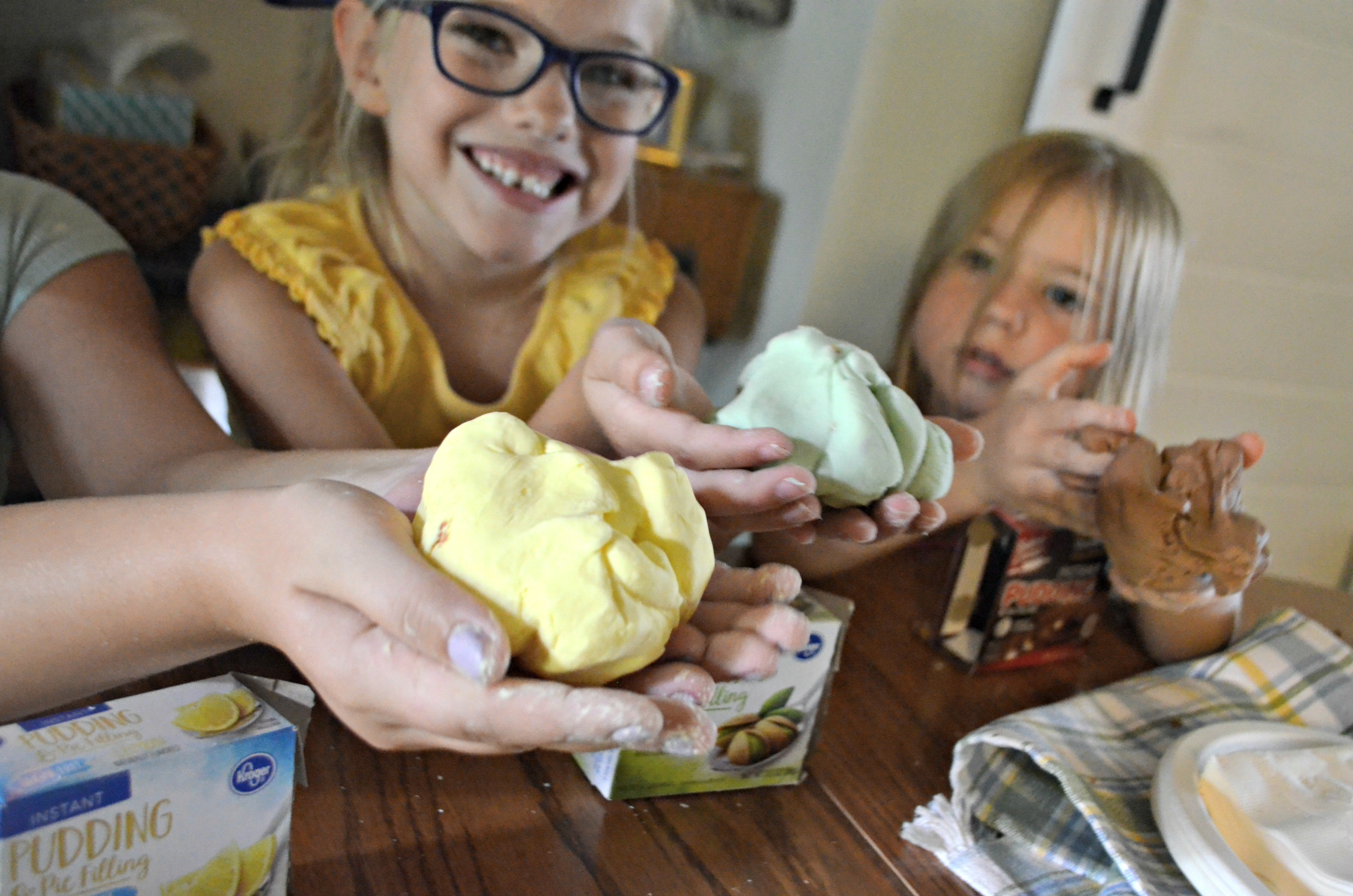 DIY play dough Pudding Slime – kids holding the slime in their hands