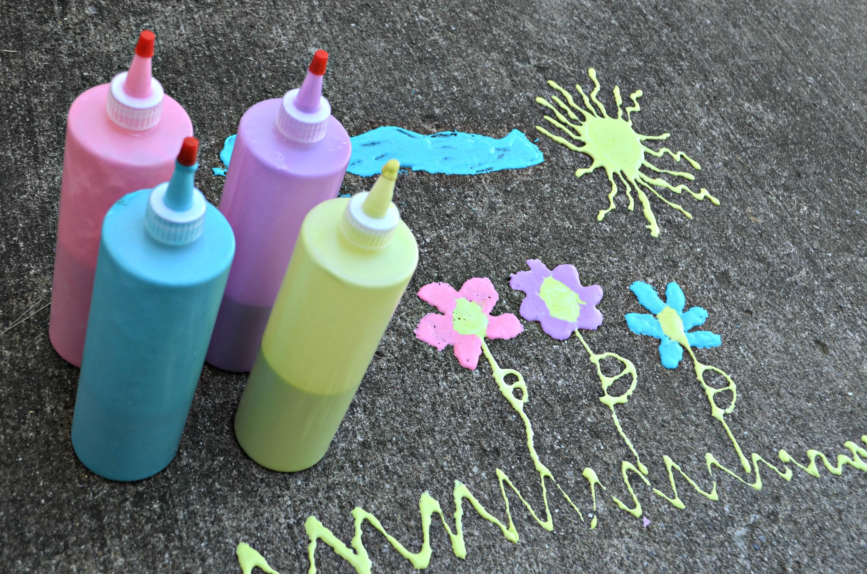 3-Ingredient DIY Puffy Sidewalk Paint - bottles of paint plus drawings in paint