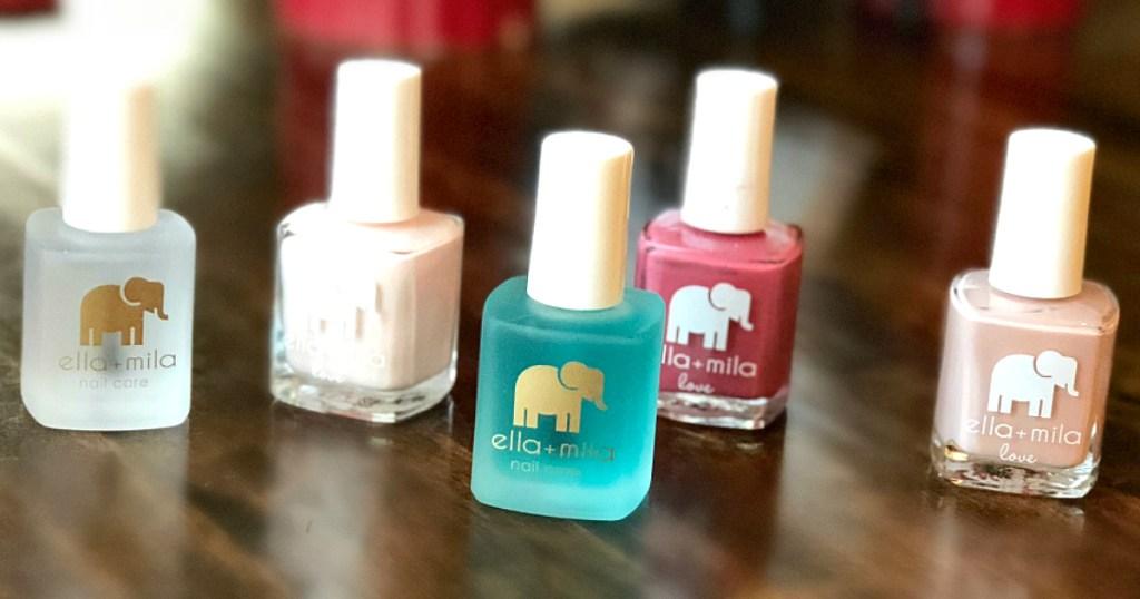 ella + mila nail polishes on counter