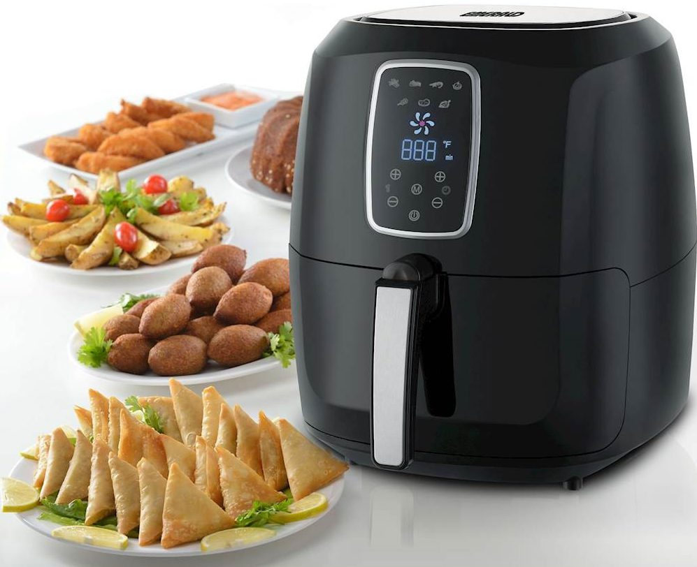air fryer with fried foods on plates next to it
