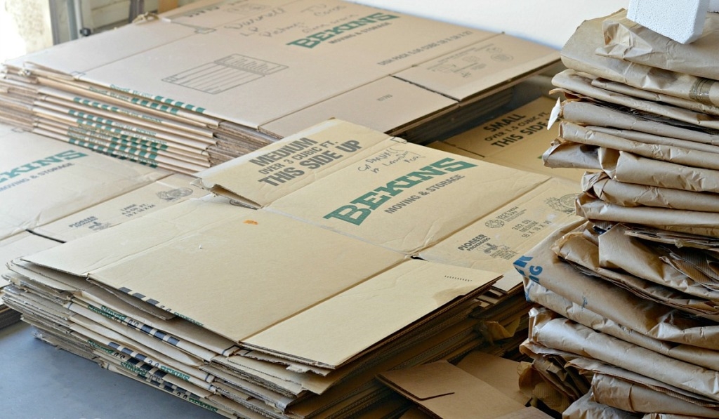 money saving moving tips — flattened moving boxes you can get for free