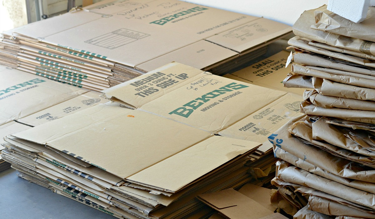 moving hacks to save money include — flattened moving boxes you can get for free