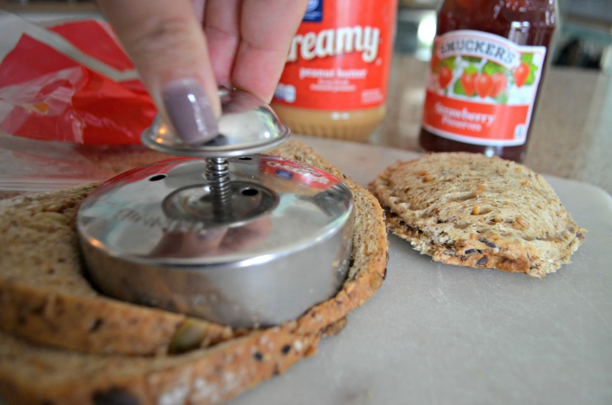 These school clever lunch box hacks are so easy – close up of the press and seal PB&J uncrustable maker