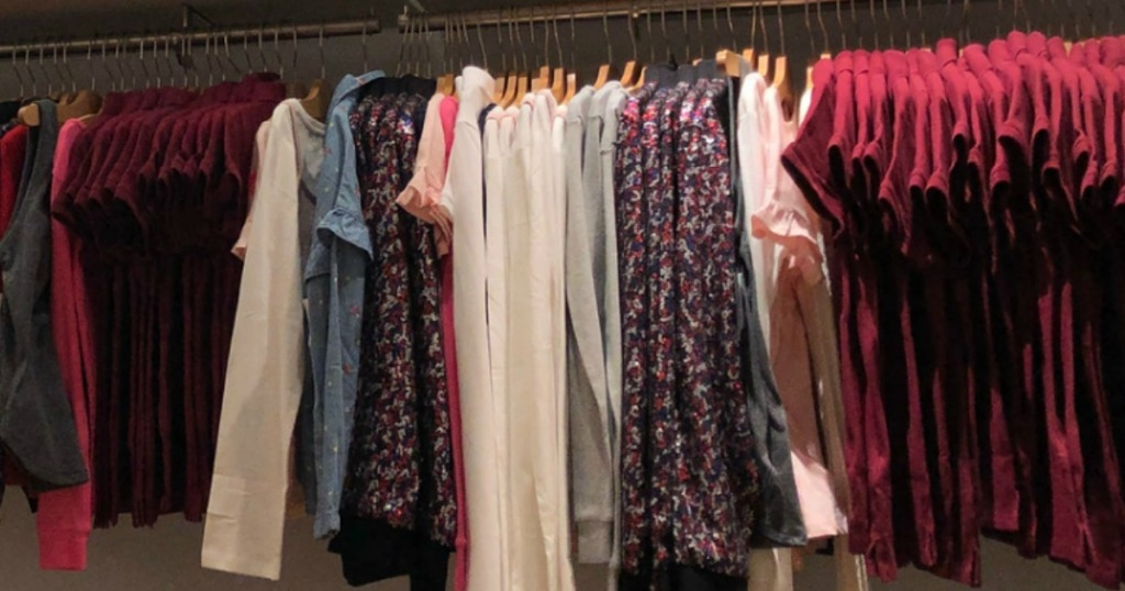 gap shirts hanging on rack in store