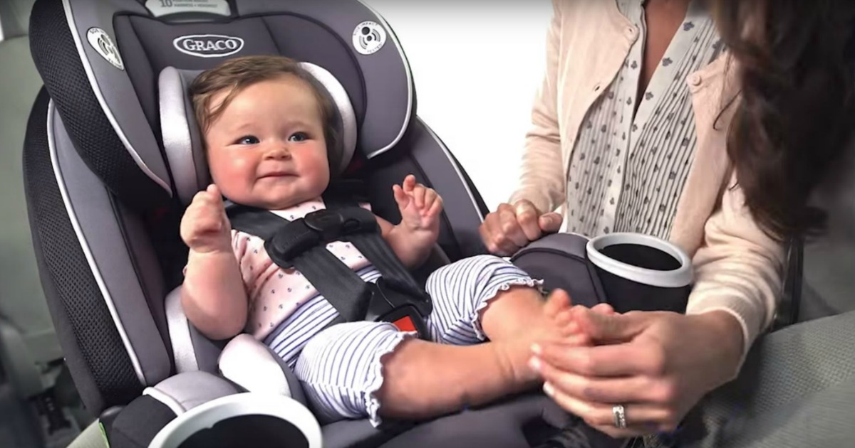 baby in a Graco car seat