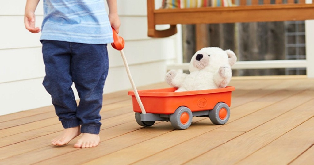 child pulling a toy wagon