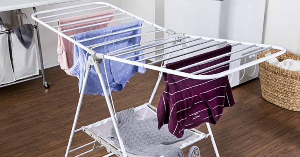 portable open drying rack with clothes hanging off it