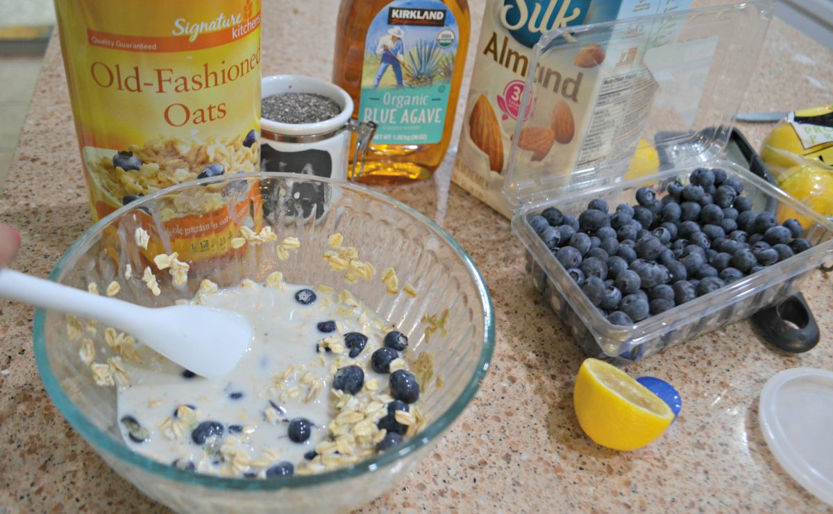 mixing ingredients for Blueberry Lemon Chia Seed Overnight Oats in a bowl