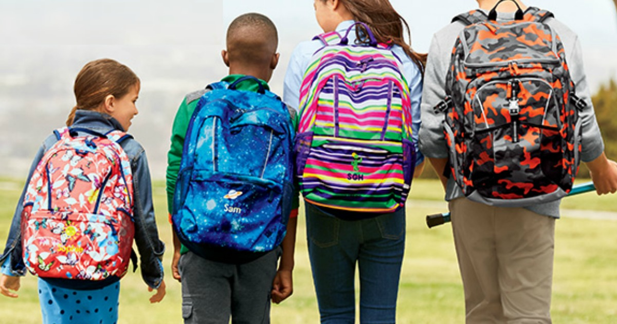 back to school deals at staples, target, and walmart - kids in backpacks walking together
