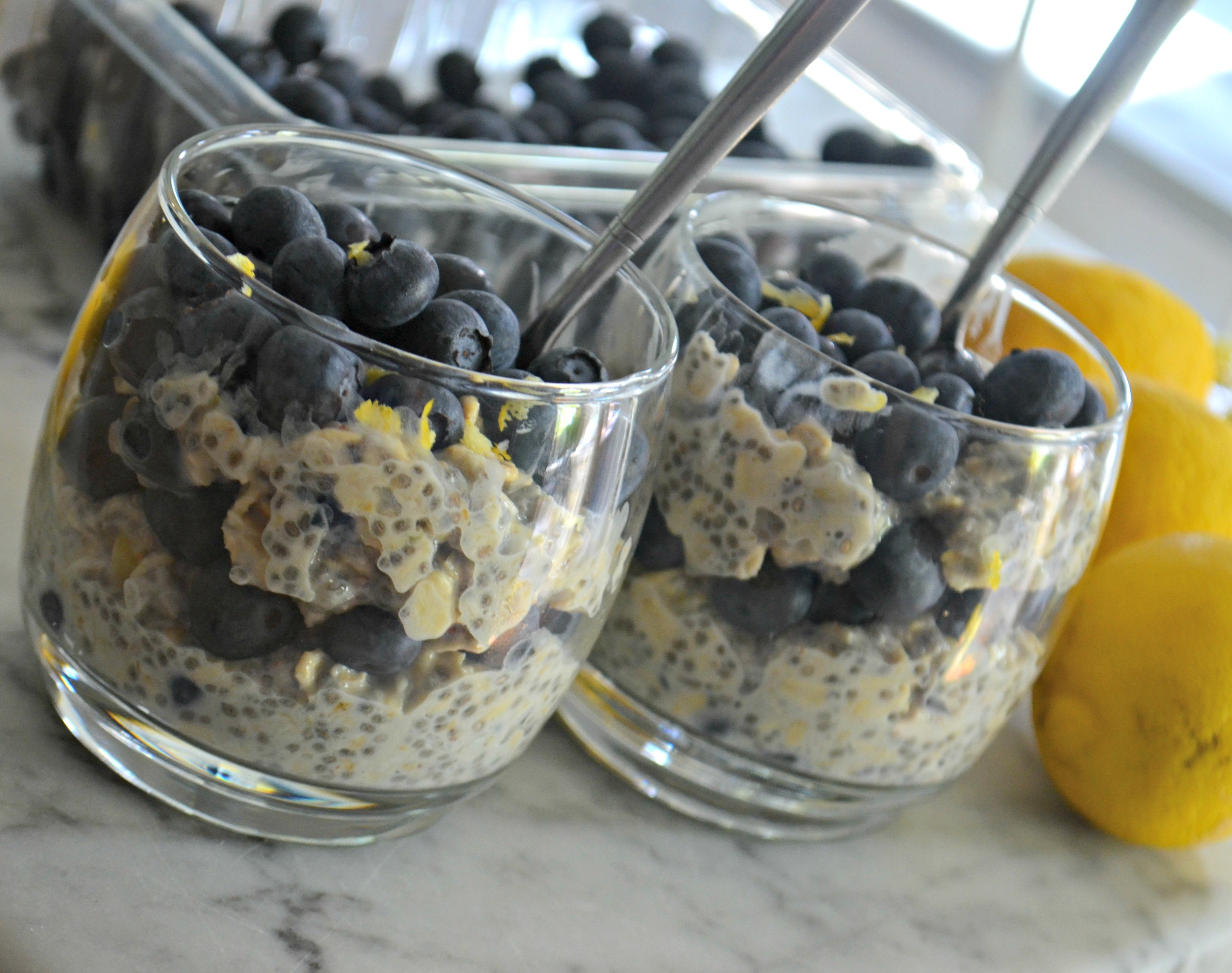 closeup with spoons in the cups of Blueberry Lemon Chia Seed Overnight Oats