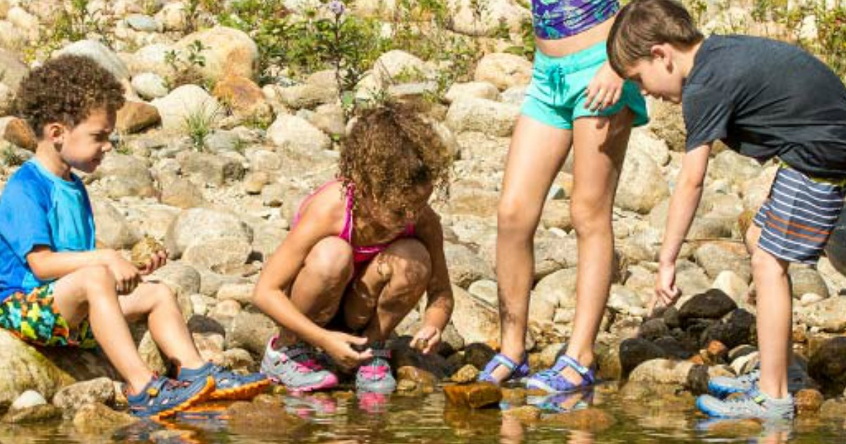 kids wearing Merrell shoes in water