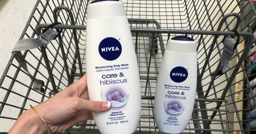 Two Nivea Body Wash bottles in a cart. One is held by a left hand.