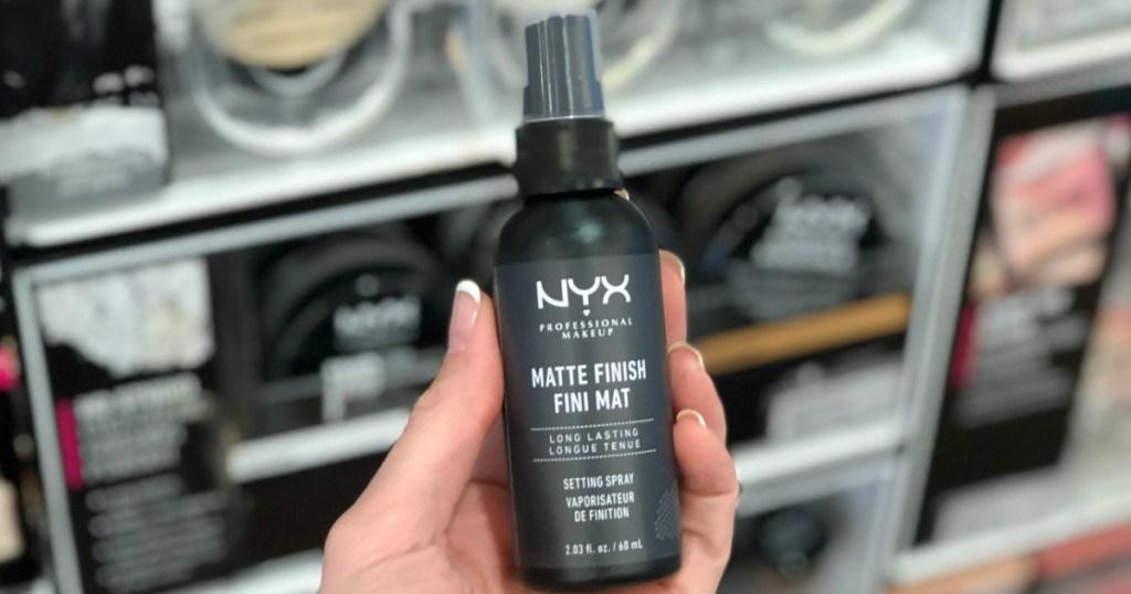 hand holding NYX Spray