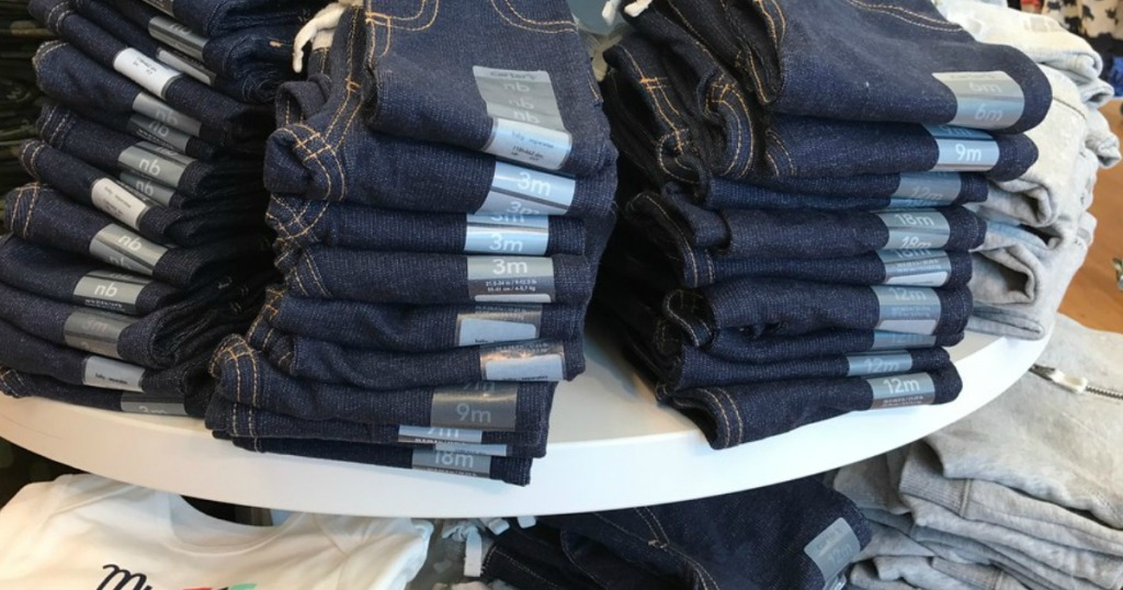 oshkosh jeans on table