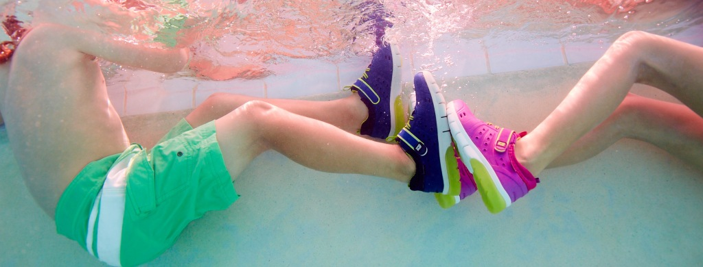 Kids wearing phibian shoes in pool
