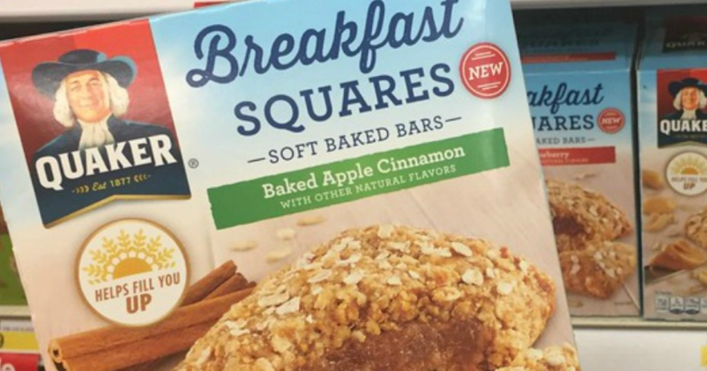 hand holding a box of Quaker breakfast squares