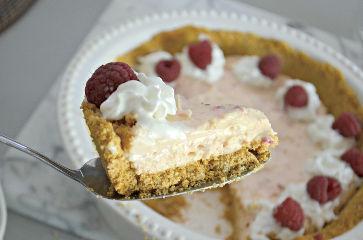 cutting a slice of raspberry pie