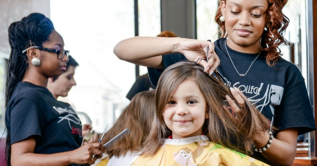 child getting free hair cut at Remington College