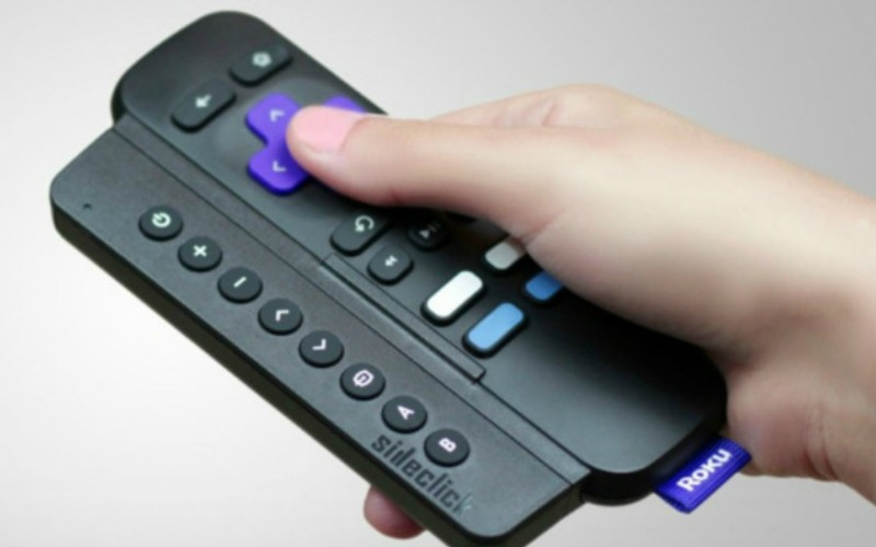 hand on roku remote