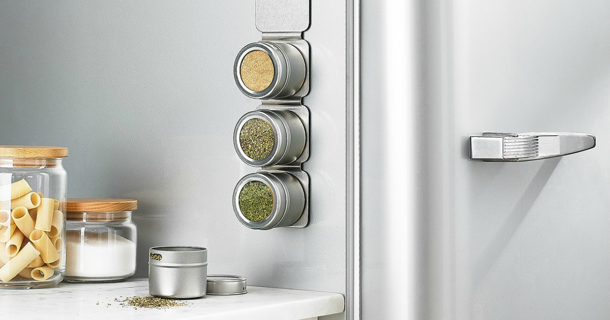 magnetic strip of spice containers handing on side of fridge