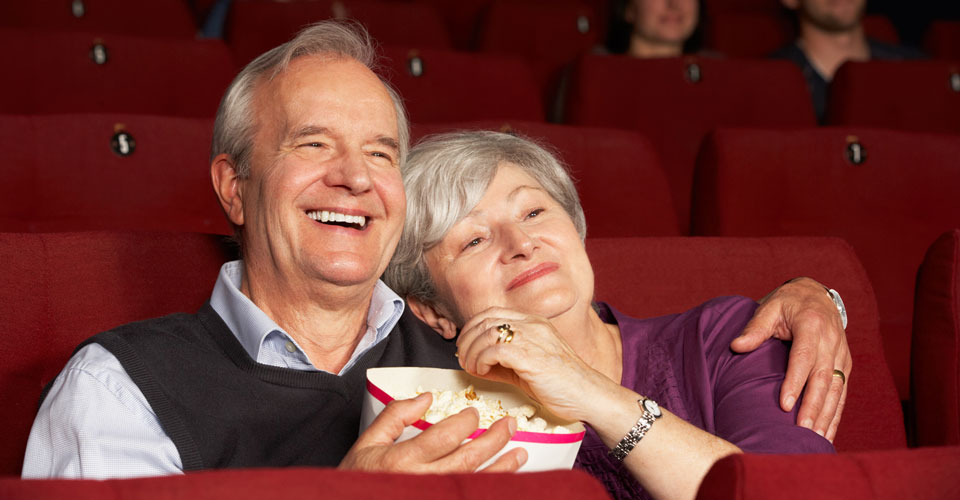 Stores, restaurants, hotels, and other places that offer senior discounts – couple watching a movie