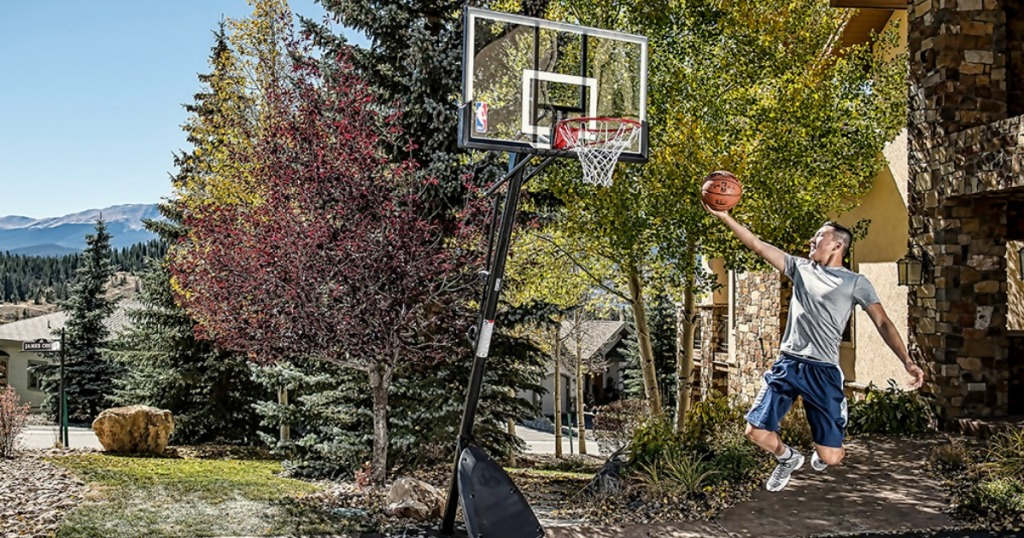 man jumping with basketball towards hoop