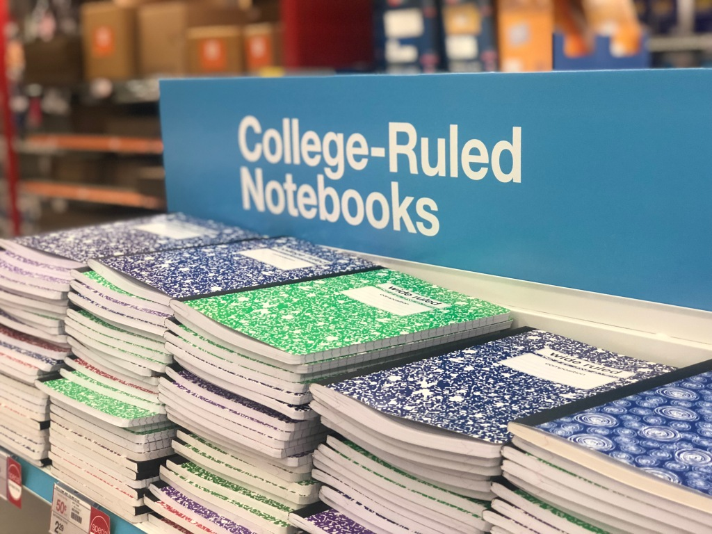 stacks of composition books displayed in store