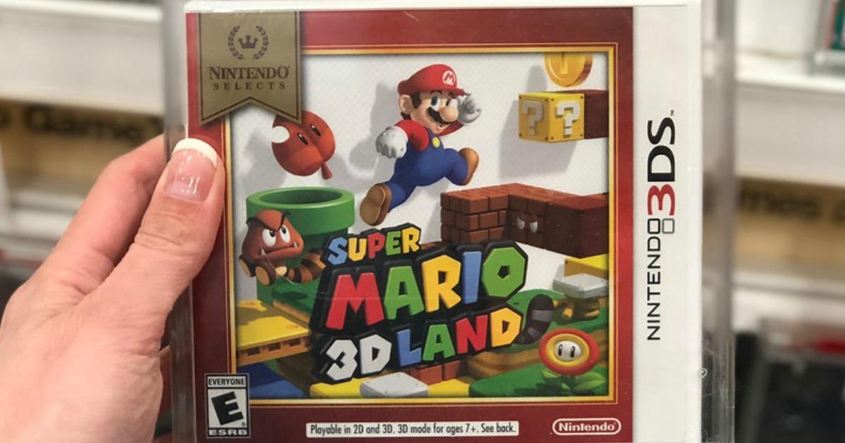hand holding Nintendo Super Mario 3D Land video game