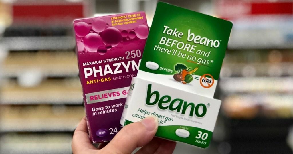 hand holding beano and phazyme proo