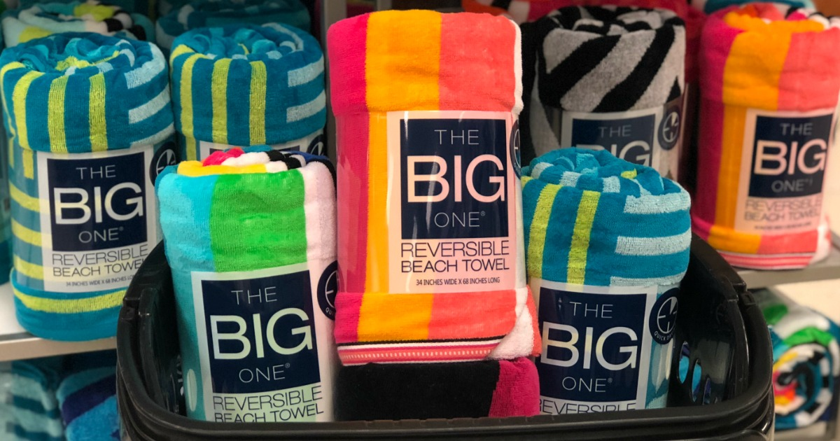 big beach ones rolled up and displayed on a shelf in a store