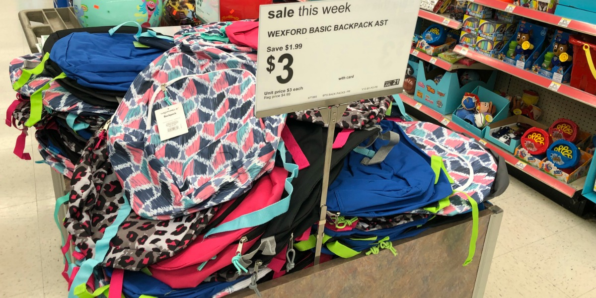 back to school deals supplies backpacks lunch bags – backpacks stacked on a table
