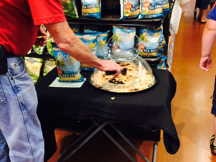 money-saving hacks at Whole Foods Market – rice chips samples on a table