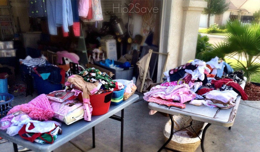 money saving moving tips —yard sale with tables of clothes