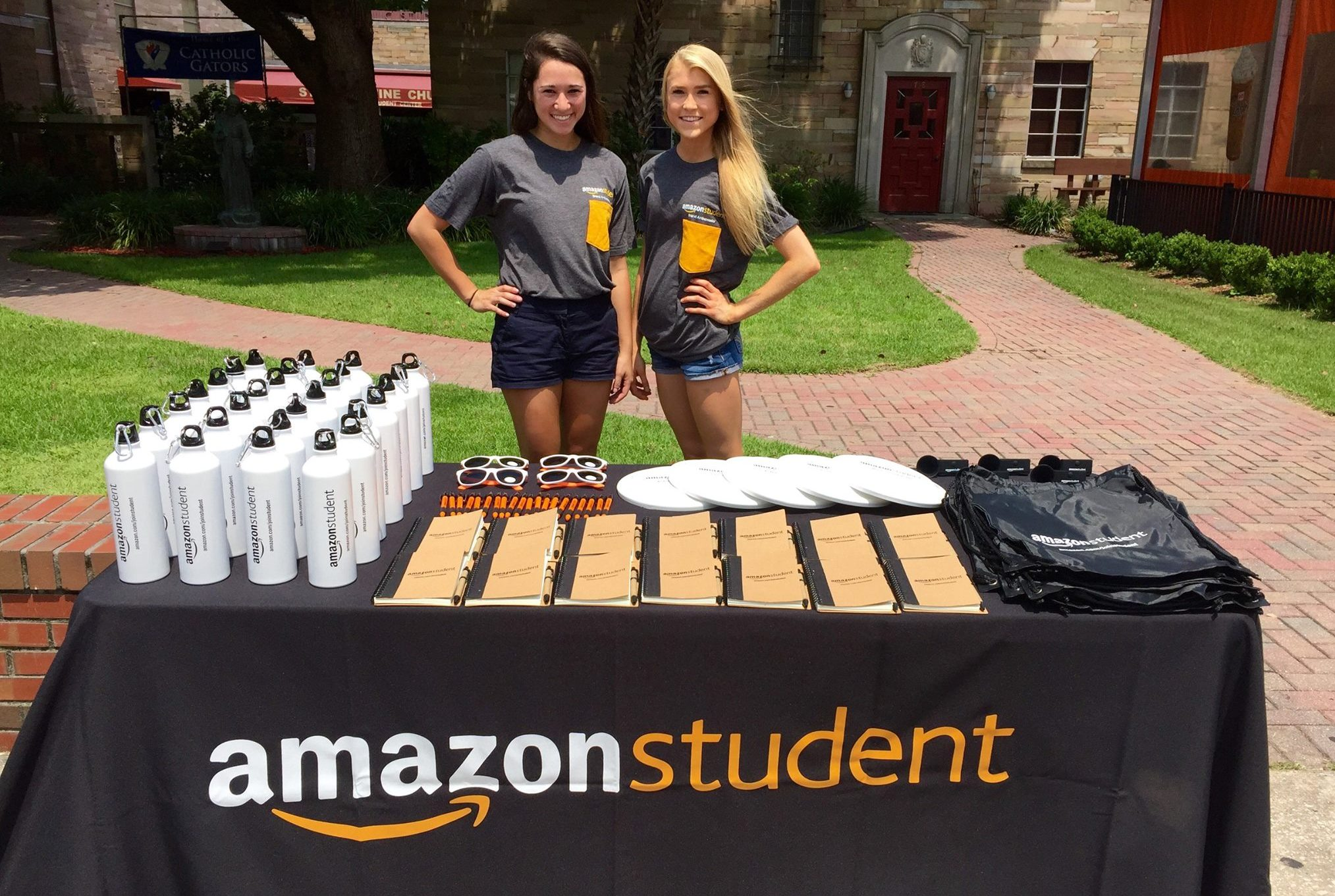 amazon college student giveaways - college students at a table giving away free items