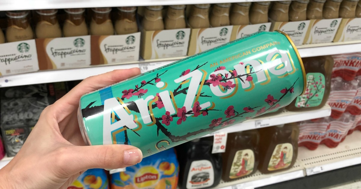 hand holding Arizona Tea can in store