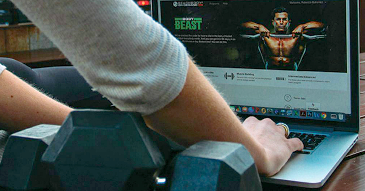 free beachbody on demand trial – typing into a laptop