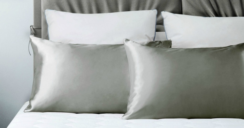silver satin pillow cases on bed