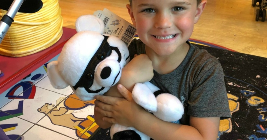 boy holding build a bear