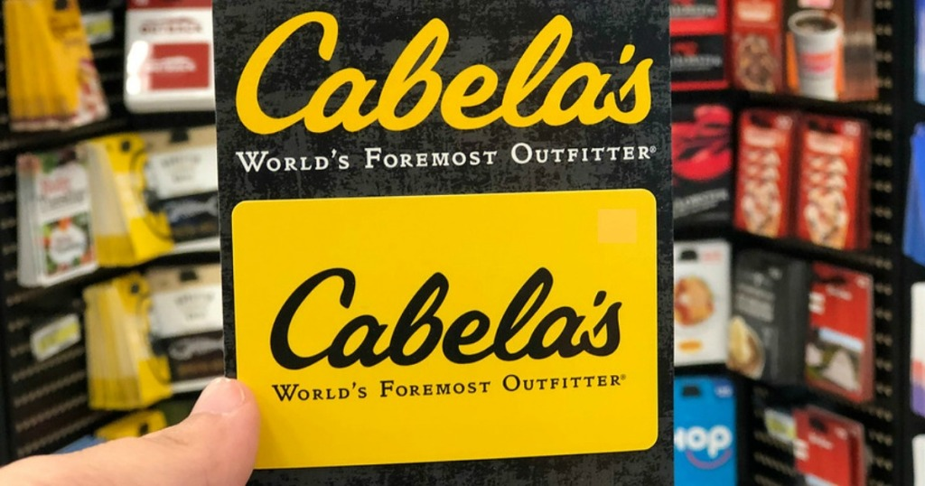 hand holding Cabela's Gift Card