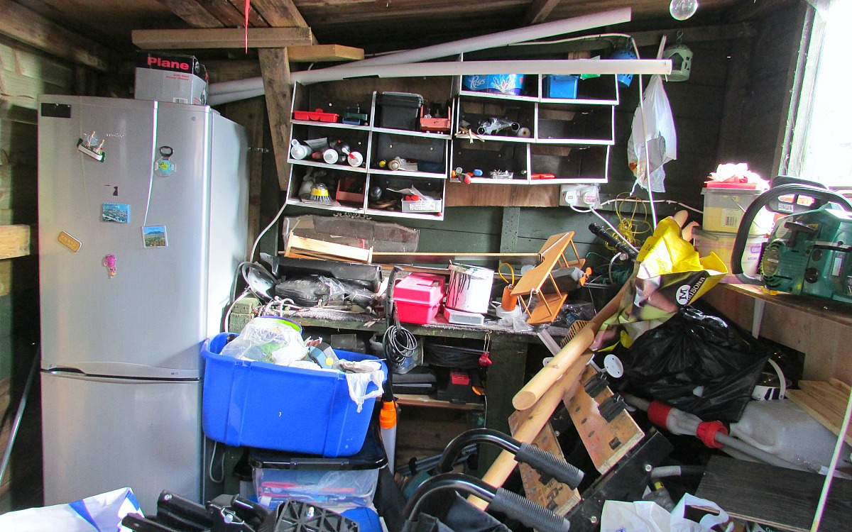 simple tricks & tips for decluttering your home — garage filled with clutter and unorganized
