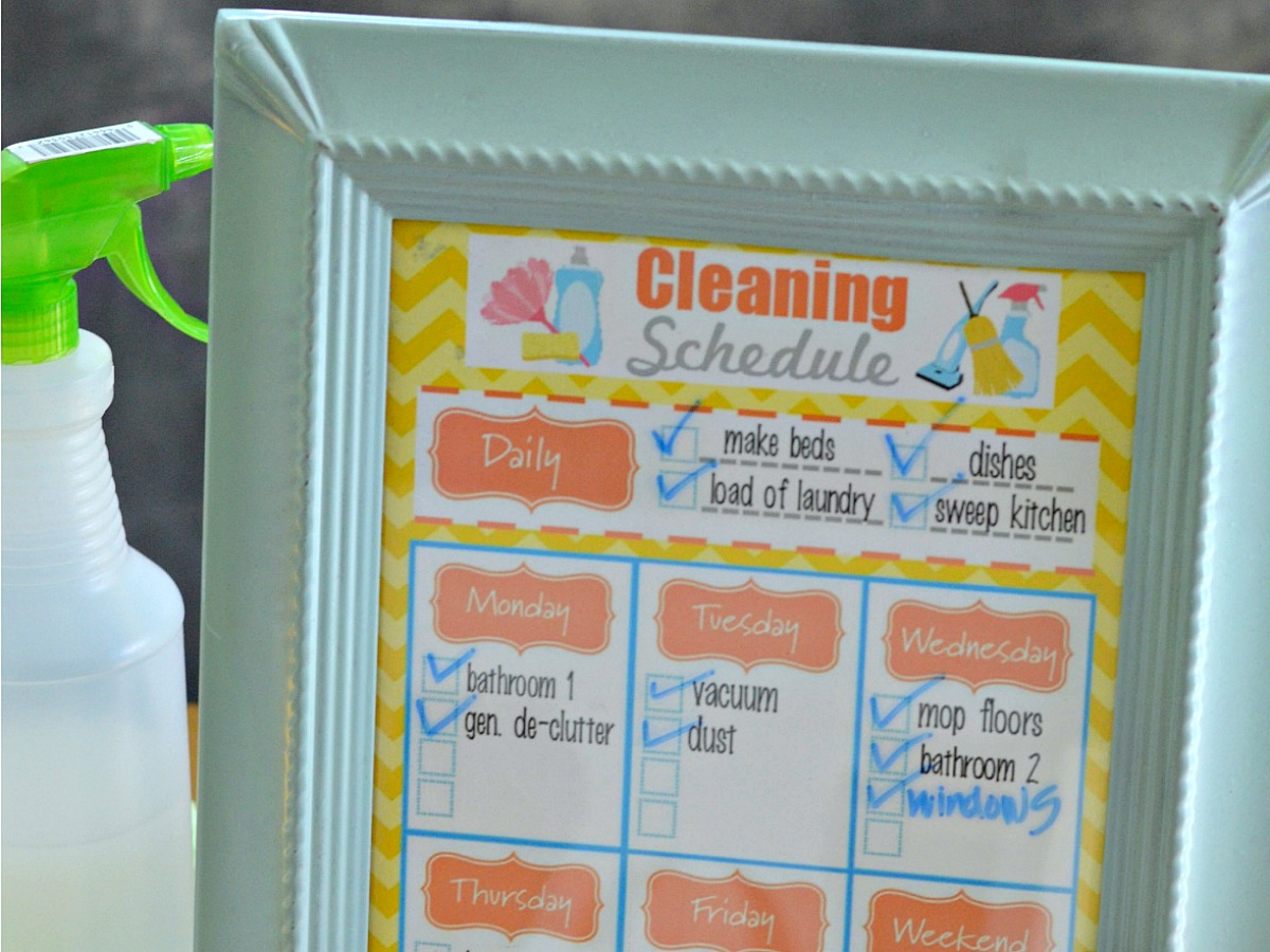 simple tricks & tips for decluttering your home — daily cleaning schedule printable in frame