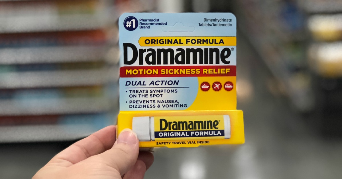 Hand holding up Dramamine Original Formula