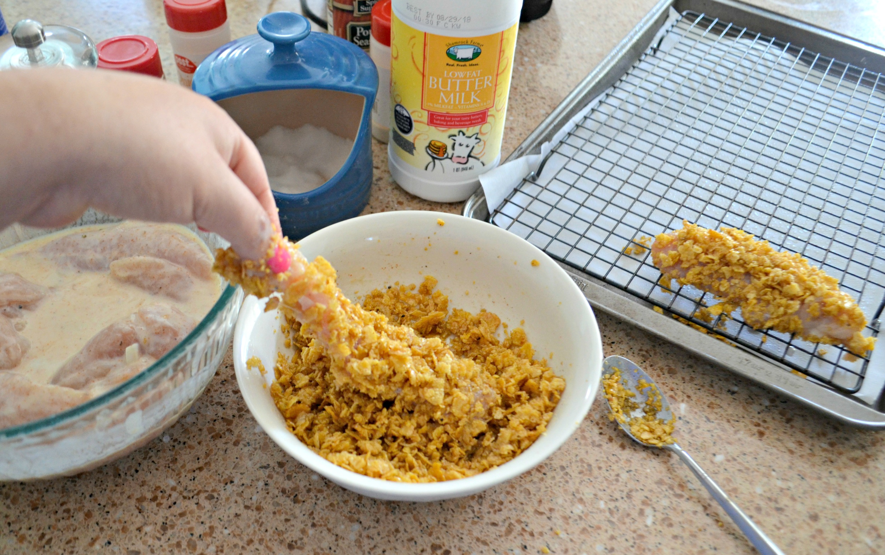 Easy Cornflake Chicken and Mini Waffles - dredging the chicken in corn flakes