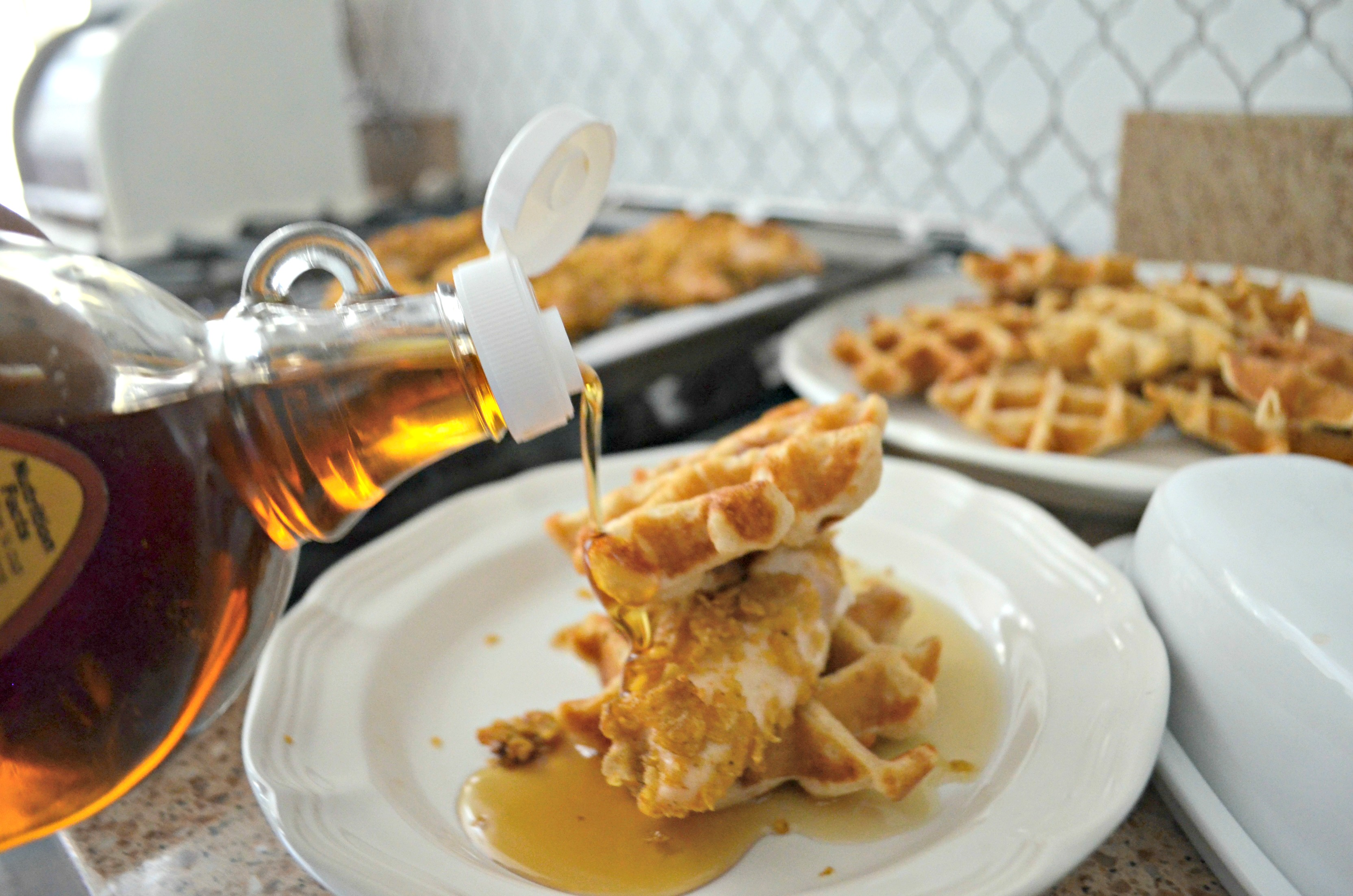 Easy Cornflake Chicken and Mini Waffles - pouring syrup over the waffles