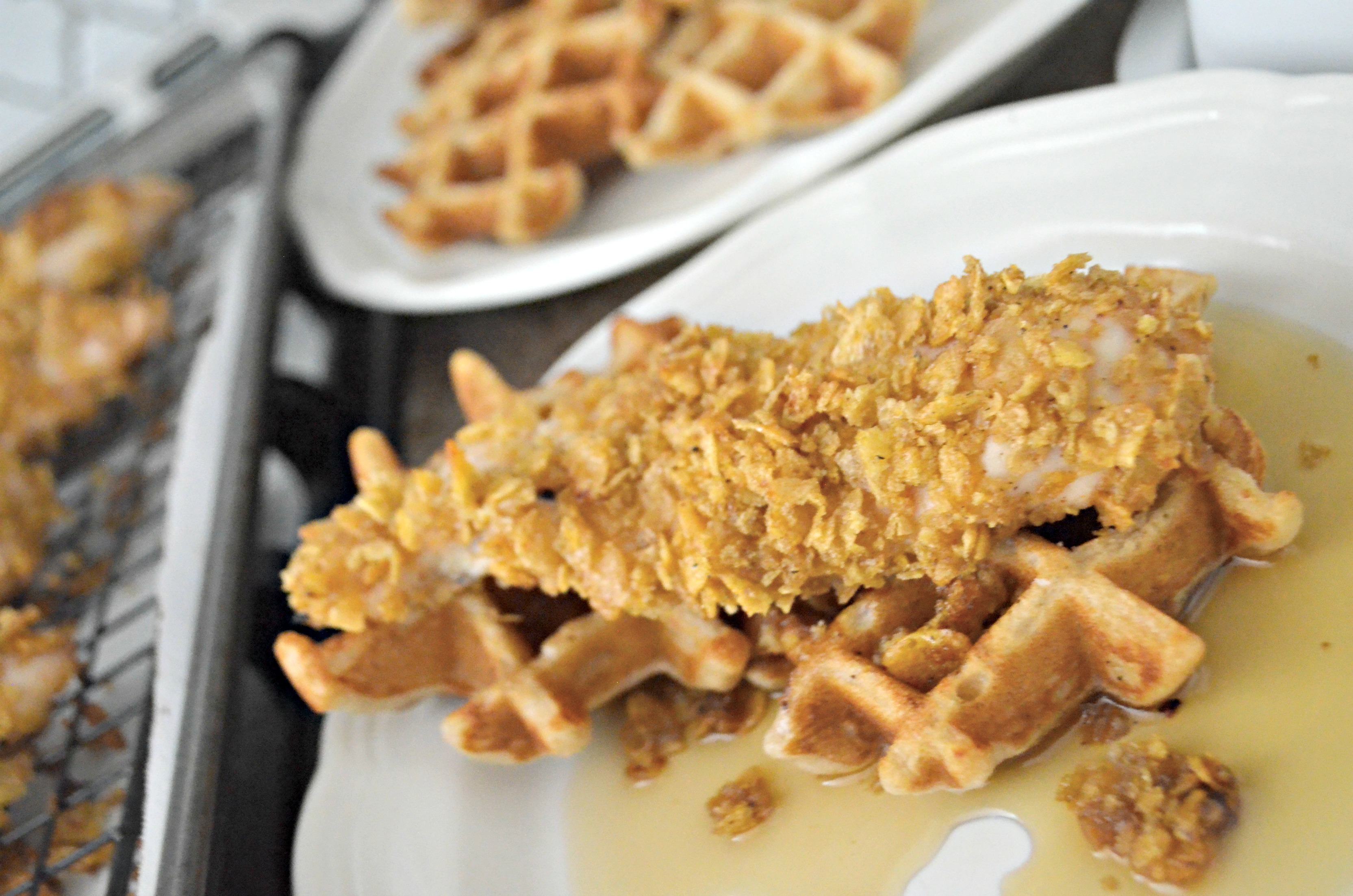 Easy Cornflake Chicken and Mini Waffles - closeup of chicken on a waffle