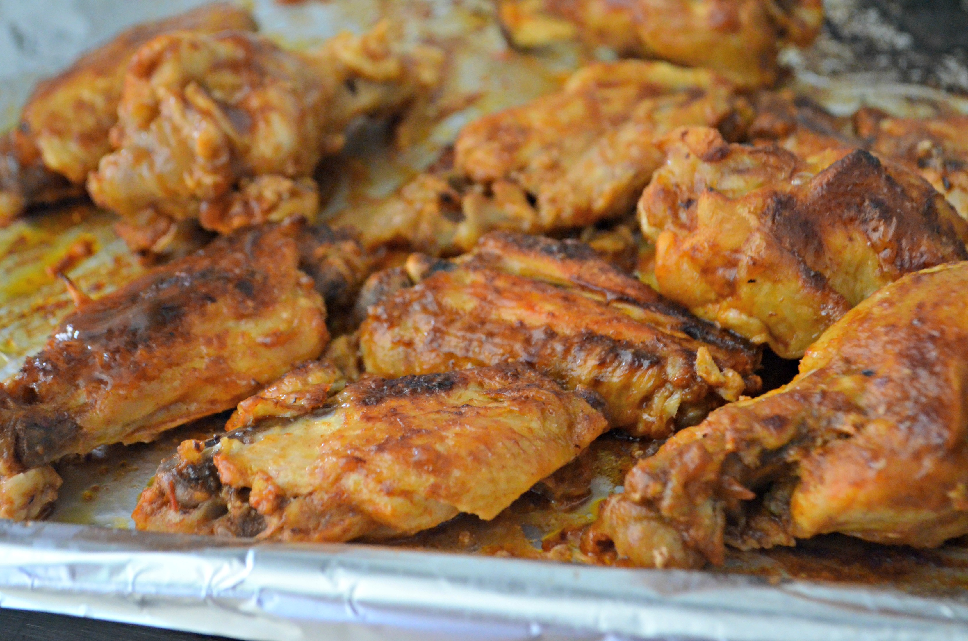 easy slow cooker buffalo bbq chicken wings - Wings on a pan after broiling briefly