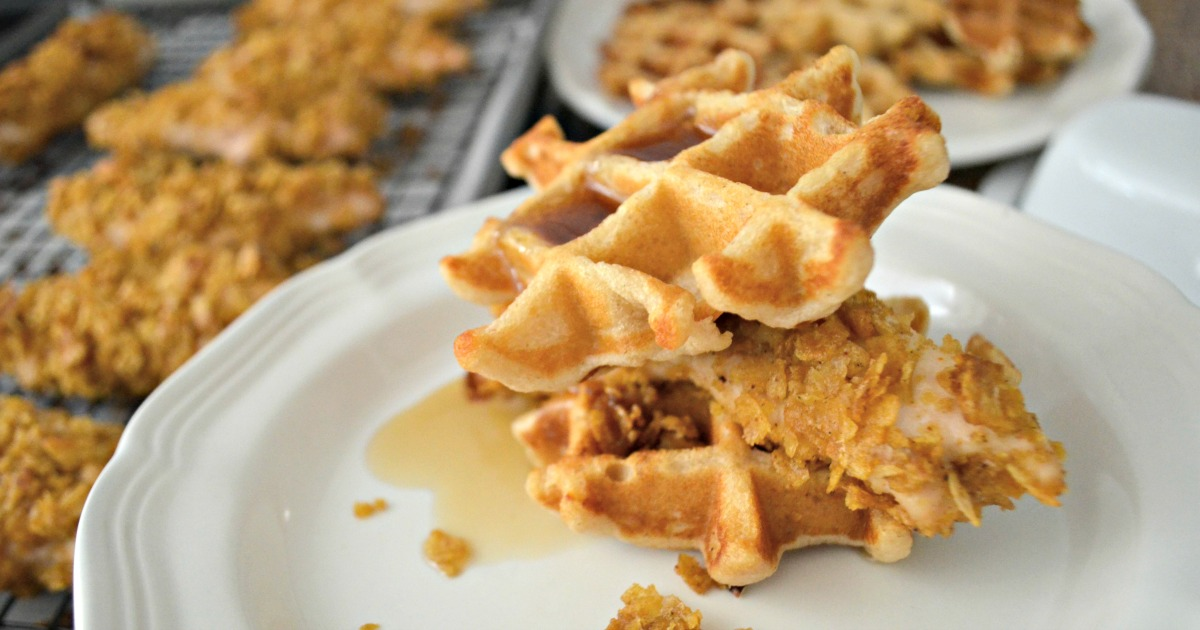 Easy Cornflake Chicken and Mini Waffles - plated as a sandwich with syrup
